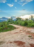 Road to the big mountain. With blue sky Stock Image