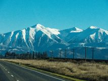 A road to the big snow mountain at South Island, New Zealand. Royalty Free Stock Photography