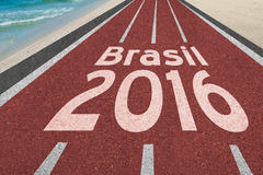Road to Brazil olympic games in Rio 2016. Running track with word Brazil in English leading to Rio de Janeiro, Brazil at the beach for 2016 olympic games Stock Image