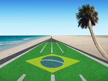 Road to Brazil olympic games in Rio 2016. Running track with word Brazil leading to Rio de Janeiro, Brazil at the beach Royalty Free Stock Images