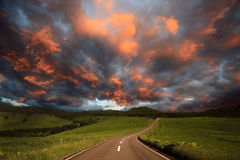 Road to burning clouds. Royalty Free Stock Photo
