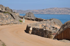 Road to the camp site on Shark Island, Luderitz Stock Images