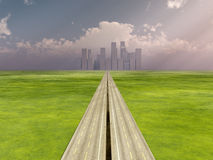 The Road To The City. A long road that is heading towards a distant city Royalty Free Stock Photos