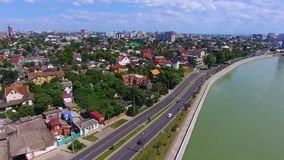 The road to the city on the river Bank.Private house. Aerial photography over the Kuban river in the southern city of. Krasnodar. Russia, 2018 stock footage