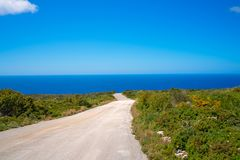 Road to the coast on Zante Island. Mediterranean sea as seen from the road leading towards the coast and shore on Zante Island, Greece royalty free stock photography