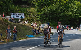 On the Road to Col d'Aubisque. Eaux-Bonnes, France, July- 15th 2011: Image of two amateur cyclists climbing the road to Col D'abisuqe,in Pyrenees Mountains Stock Images