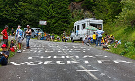 Road to Col d'Aubisque. Gourette, France, July 15th 2011: Image of fans near the road to mountain pass Aubisque few minutes before arrival the cyclists during Royalty Free Stock Images