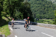 On the Road to Col d'Aubisque. Laruns,France,July 15th 2011: Image of a boy and his father climbing on the road to mountain pass Aubisque just before the passing Stock Image