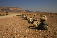 Road to desert. Deserted landscape with stones and road (Syrian desert Stock Photo