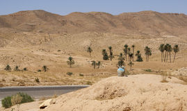At road to desert. Jug with water on пригорке at road to desert Sahara in Tunis Stock Photography