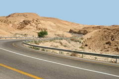 Road to desert. The highway among mountains in the Israeli desert leads to the Dead Sea Royalty Free Stock Image