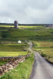 Road to Doonagore. A road extends toward Doonagore Castle, Doolin, Ireland Stock Photography