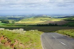 Road To Edinburgh Through East Lothian Hills, Scotland. Road and roadside verge in foreground with a view over the rolling East Lothian Hills, near Edinburgh Royalty Free Stock Image