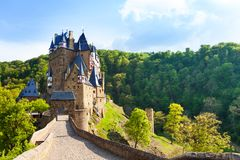 Road to the Eltz castle with towers, in hills. Road to the Eltz castle with towers in the forest, Rhineland-Palatinate, Germany, Europe Stock Photos