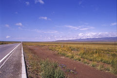 The road to the end. Maybe you can see the end, maybe not. it is so straight that like beeline. it is a free feeling.by the way, the road is the QingHai lake Royalty Free Stock Photos