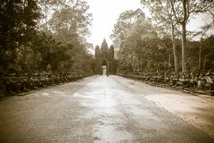 Road to entrance of Angkor Thom at Angkor Wat Complex. Road leads to the Angkor Thom historic Buddhist complex near Siem Reap Cambodia. Ancient ruins of the stock images