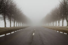 Road to a fog Stock Photos