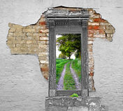 Road to freedom. Photo showing brick wall with peeling paint and a doorway leading to freedom stock illustration