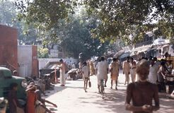 1975. India. Road to Ganges, 2. Varanasi. The picture shows a road leading to Ganges with devotees on their way to and from a holy bath Stock Photos