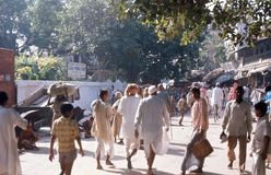 1975. India. Road to Ganges. Varanasi. The pictures shows a road leading to Ganges, with pilgrims on their way to a holy bath Royalty Free Stock Images