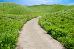 Road to the green hill Royalty Free Stock Photography