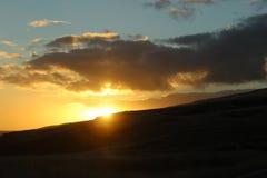 Road to Hana Sunset Hawaii. Beautiful partially cloudy sunset on the Road to Hana in Hawaii. Maui Stock Images