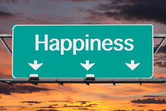 Road to happiness Freeway Sign. With sunrise sky Royalty Free Stock Images
