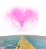 Road to heart shaped cloud Stock Image