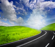 Road to heaven. Road and cloudy sky in summer Royalty Free Stock Photo