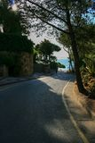 Lonely tarmac road to entrance of villa by the seaside and way t stock images
