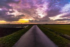 The road to heaven is ready. The road to nowhere was taken on a winter morning in holland at sunrise. All those beautiful colors Royalty Free Stock Photo