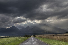 Road to high Tatras with dramatic sky. Road to high Tatras with very dramatic sky Royalty Free Stock Photo