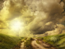 Road to the hill in the clouds. Dirt road to the hill in the clouds (illustration of a fictional situation, in the form collage of photos Royalty Free Stock Photos