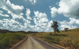 Road to hill. And cloudy background (retro effect Royalty Free Stock Photo