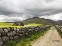 A road to the hills. An old derelict house in a country setting in the mournes ireland Royalty Free Stock Images