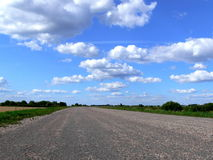Road in to horizon. Highway in to the horizon of summer landscape Stock Images