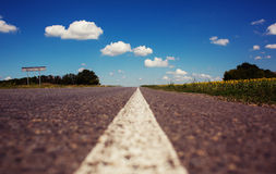 Road to horizon in cloudy sky Royalty Free Stock Images