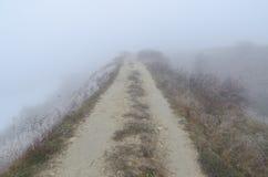 Road to horizon in fog Royalty Free Stock Photos