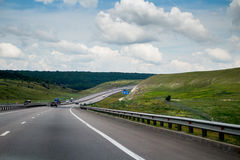 Road to horizon. Travel in sunny day at the car Royalty Free Stock Image
