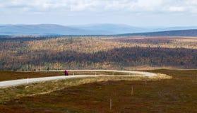 Road to Kaunispää. A couple walking down the winding road from Kaunispää fell in Finnish Lapland stock photo