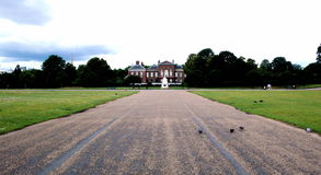 Road to Kensington Palace. The road leading up to Kensington palace in London, with grassy field on both side. This is the view from Lady Diana's house royalty free stock photos