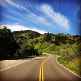 Road to lake berryessa. Northern California highway green mountains curvy roads pasture Stock Image