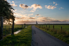 Road to the lighthouse at sunrise Stock Photo