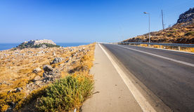 Road to Lindos village. Beautiful summer landscape of Rhodes island royalty free stock photo