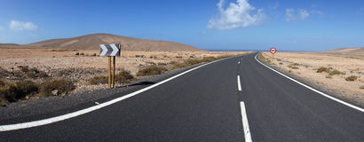 Road to Los Molinos, Fuerteventura, Canary Islands. The road through rocky and volcanic deserts. Near Los Molinos, Fuerteventura, Canary Islands royalty free stock photos