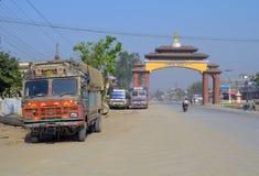 Road to Lumbini gate, Nepal - birthplace of Buddha Siddhartha Gautama. Urban landscape with truck stock images