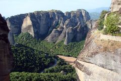 The rocks of St. Meteora in the central part of Greece. 06. 18. 2014. Landscape of mountainous nature, settlements and religious o. The road to the male Greek Stock Image