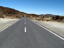 Road to Mars. Highway in the desert-like Teide national park, Tenerife, Spain Stock Photos