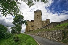 Road to the medieval castle of Mauvezin, hautes pyrenees, Occitanie, France. Medieval castle in french village of Mauvezin, hautes pyrenees, France stock photos