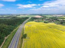 The road to Minsk, Belarus. Flying above yellow field. Drone photo stock photography